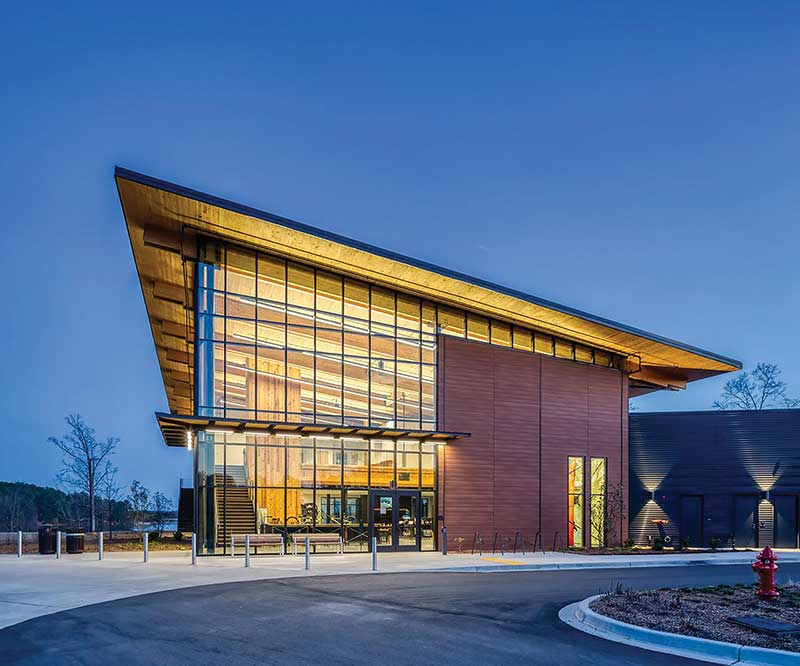 Andy Quattlebaum Outdoor Recreation Center at Clemson University - angled mass timber building at night