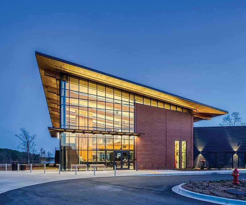 Andy Quattlebaum Outdoor Recreation Center at Clemson University - angled mass timber building at night