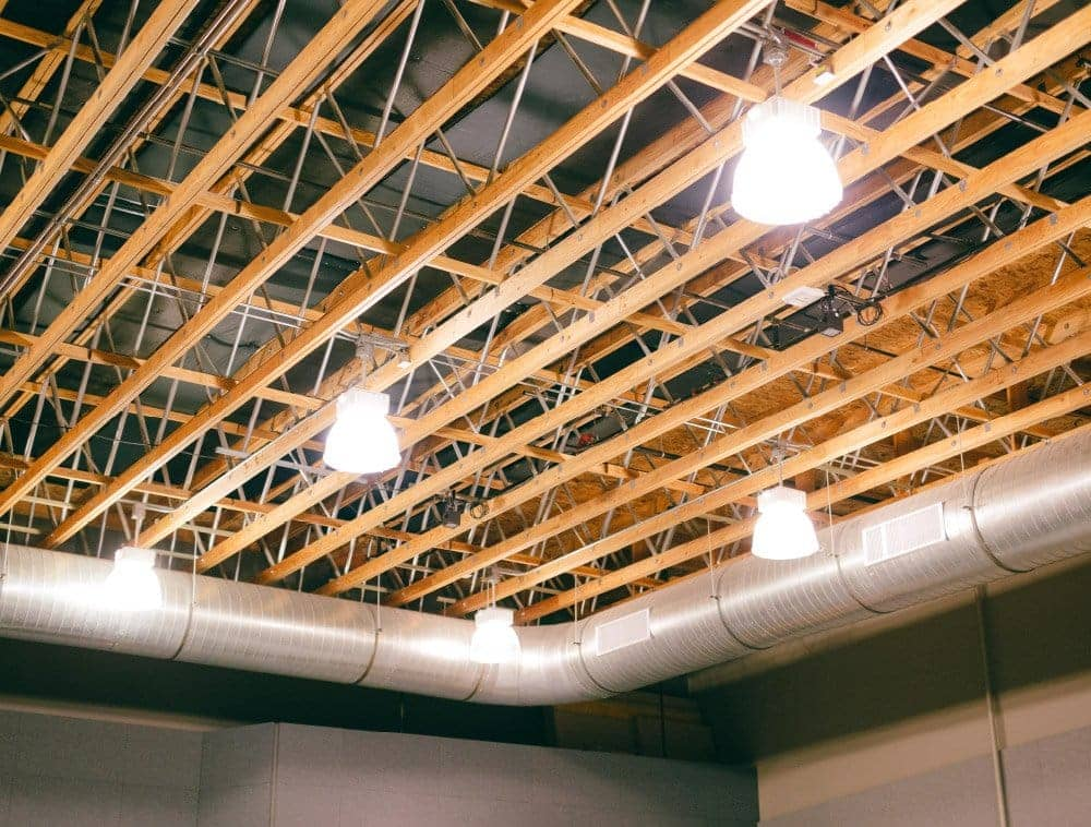 A church auditorium ceiling shows exposed open web trusses