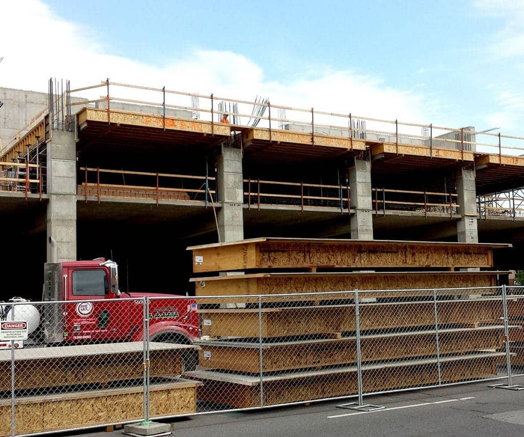 A simple parking garage structure stands ready for the next phase of a concrete forming project