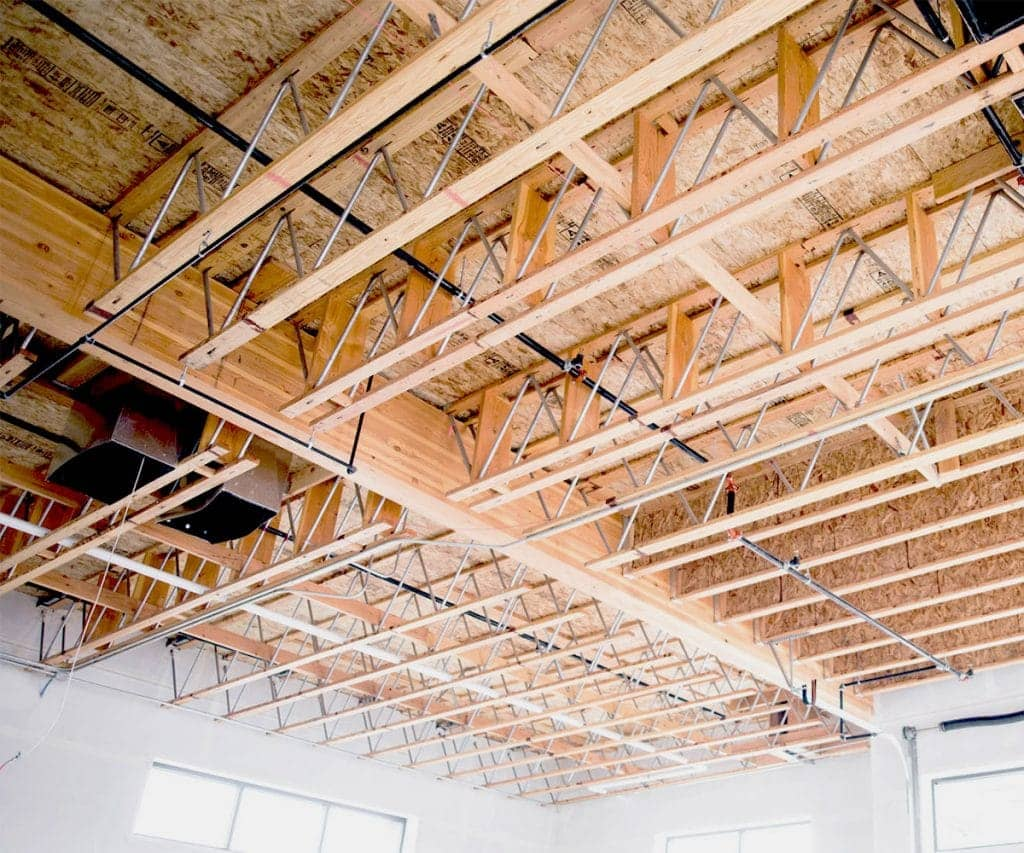 Both glulam and open web trusses are seen in this exposed space