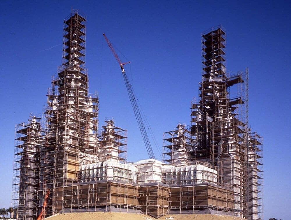 A structure is being build with scaffold planks all around it
