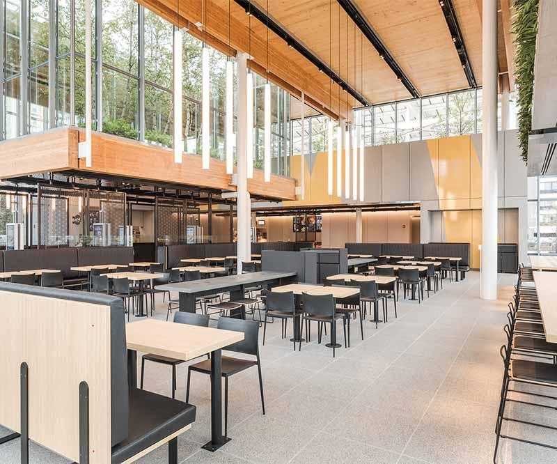 Spacious interior of McDonald's Flagship Store built with mass timber