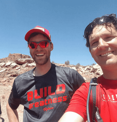 A RedBuilt staffer poses with a buddy while hiking