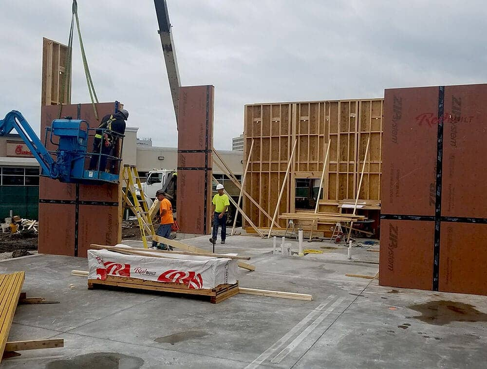 Wall panels are being installed on a site