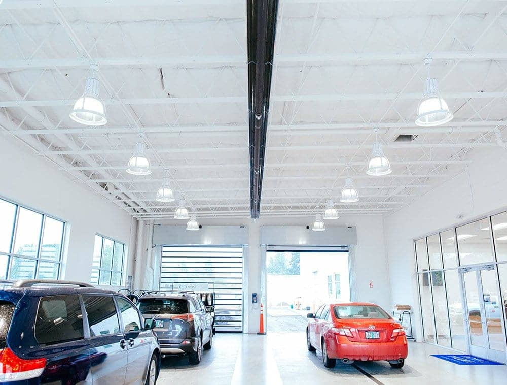 White Tapered Open Web Trusses in a garage with three cars